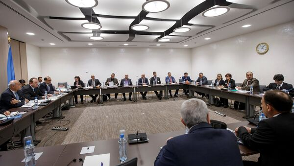 Deputy UN Special Envoy for Syria Ramzy Ezzeldin Ramzy and Syria's main opposition High Negotiations Committee (HNC) leader Nasr al-Hariri attend a round of negotiation during the Intra Syria talks at the European headquarters of the United Nations in Geneva, Switzerland, Monday, March 27, 2017 - Sputnik International