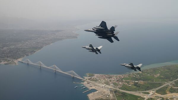 In this photo released by the Hellenic Air Force, two Greek F-16 fighter jets and a USAF F-15E Strike Eagles, based at Lakenheath airbase in England, fly past the 2,880-meter Rio-Antirrio Bridge in southern Greece, on Wednesday, April 13, 2016. The U.S. jets took part in Exercise Iniohos 2016, in southern Greece, together with military aircraft from Greece and Israel. - Sputnik International
