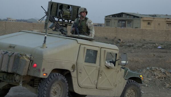 US soldier sits on top of a Humvee - Sputnik International