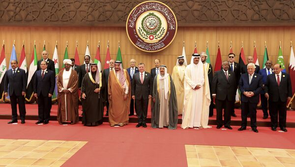 Twenty one kings, presidents and top officials from the Arab League summit pose for a group photo, at a gathering near the Dead Sea in Jordan - Sputnik International