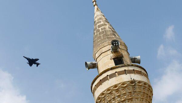 A Turkish Air Force F-4 fighter jet flies over a minaret after it took off from Incirlik air base in Adana, Turkey, August 12, 2015. - Sputnik International
