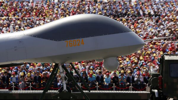 FILE - In this file photo taken Thursday, Sept. 3, 2015, the front of the Wing Loong, a Chinese made medium-altitude long-endurance unmanned aerial vehicle, moves past spectators during a parade commemorating the 70th anniversary of Japan's surrender during World War II held in Beijing. - Sputnik International