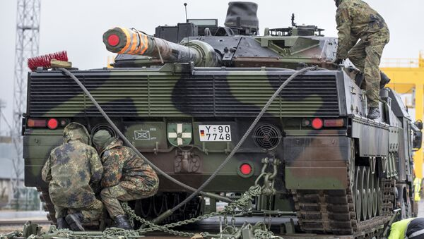 German army soldiers load a Leopard 2 tank onto a truck at the Sestokai railway station some 175 kms (109 miles) west of the capital Vilnius, Lithuania, Friday, Feb. 24, 2017. - Sputnik International