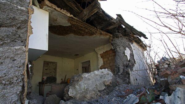 The house, damaged as a result of shelling, in the Kiev district of Donetsk - Sputnik International