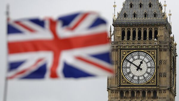 British Union flag waves in front of the Elizabeth Tower at Houses of Parliament containing the bell know as Big Ben in central London - Sputnik International