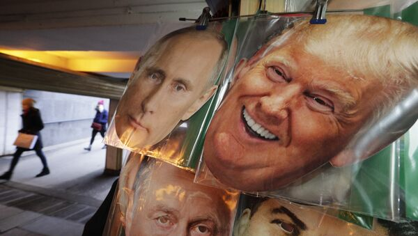 In this Monday, Feb. 20, 2017 photo face masks depicting Russian President Vladimir Putin and US President Donald Trump hang on sale at a souvenir street shop in St.Petersburg, Russia - Sputnik International