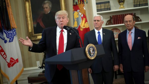 U.S. President Donald Trump speaks during a signing ceremony of executive orders on trade, accompanied by Vice President Mike Pence (C) and U.S. Commerce Secretary Wilbur Ross (R) at the Oval Office of the White House in Washington, U.S., March 31, 2017 - Sputnik International