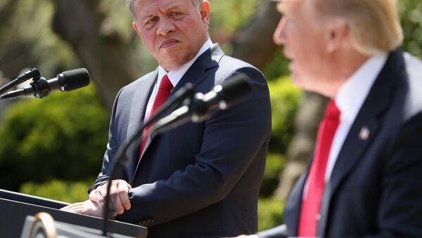 Jordan's King Abdullah II listens as President Donald Trump speaks during their news conference in the Rose Garden at the White House in Washington, Wednesday, April 5, 2017 - Sputnik International