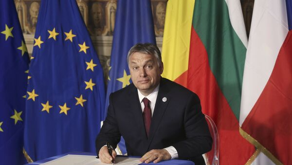 Hungary's Prime Minister Viktor Orban signs a document during the EU leaders meeting on the 60th anniversary of the Treaty of Rome, in Rome, Italy March 25, 2017. - Sputnik International