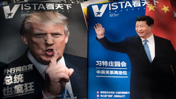 Magazines featuring front pages of US President Donald Trump (L) and China's President Xi Jinping (R) are displayed at a news stand in Beijing - Sputnik International