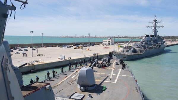 In this photo provided by the U.S. Navy, the Arleigh Burke-class guided-missile destroyer USS Ross (DDG 71) departs Rota, Spain, on March 29, 2017. - Sputnik International