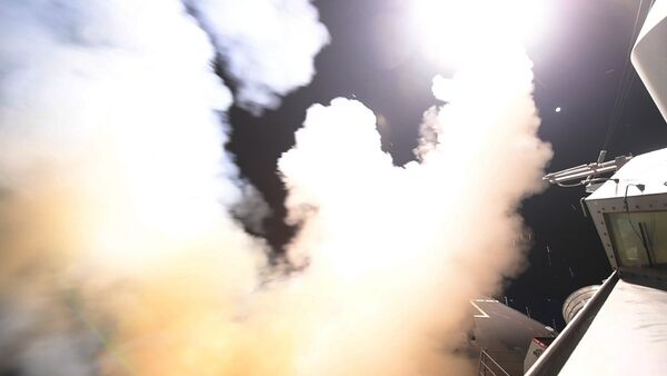In this image provided by the U.S. Navy, the guided-missile destroyer USS Porter (DDG 78) launches a tomahawk land attack missile in the Mediterranean Sea, Friday, April 7, 2017. - Sputnik International
