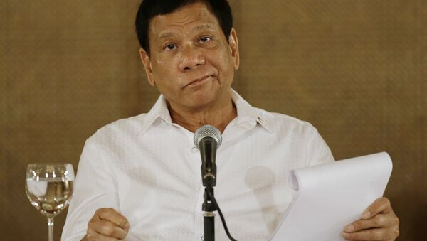 In this Monday, March 13, 2017 file photo, Philippine President Rodrigo Duterte reacts during a press conference at the Malacanang presidential palace in Manila, Philippines. - Sputnik International