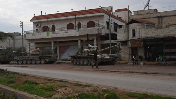 Armored vehicles in a village in the north of Hama, Syria - Sputnik International