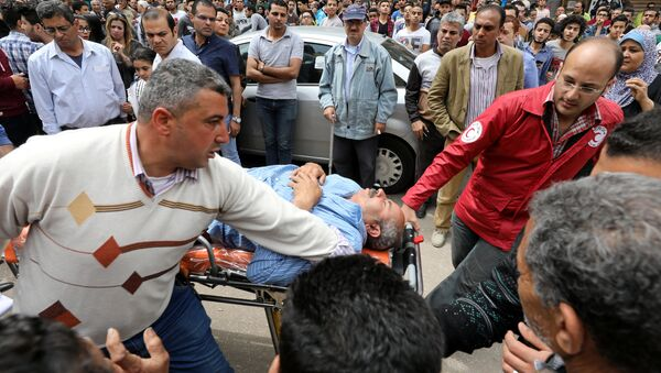A victim is seen on a stretcher after a bomb went off at a Coptic church in Tanta, Egypt, April 9, 2017 - Sputnik International