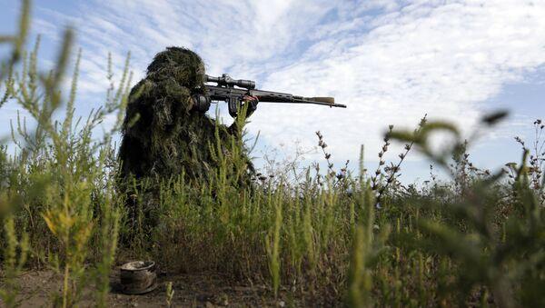 A Ukrainian sniper holds on the position of Ukrainian forces on frontline in the Lugansk region on August 27, 2015 - Sputnik International
