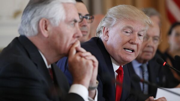 President Donald Trump, joined by Secretary of State Rex Tillerson, left, speaks during a bilateral meeting with Chinese President Xi Jinping at Mar-a-Lago, Friday, April 7, 2017, in Palm Beach, Fla - Sputnik International