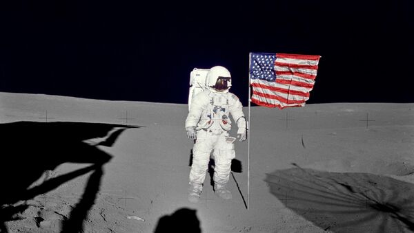 Apollo 14 Mission image - Astronaut Edgar D. Mitchell, lunar module pilot for the Apollo 14 lunar landing mission, stands by the deployed U.S. flag on the lunar surface during the early moments of the first extravehicular activity (EVA-1) of the mission. - Sputnik International