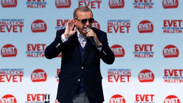 Turkish President Tayyip Erdogan addresses his supporters during a rally for the upcoming referendum, in Izmir, Turkey, April 9, 2017. - Sputnik International