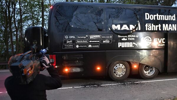 A camera man films Dortmund's team bus after it was damaged in an explosion before the Champions League quarterfinal soccer match between Borussia Dortmund and AS Monaco in Dortmund, western Germany, Tuesday, April 11, 2017. - Sputnik International