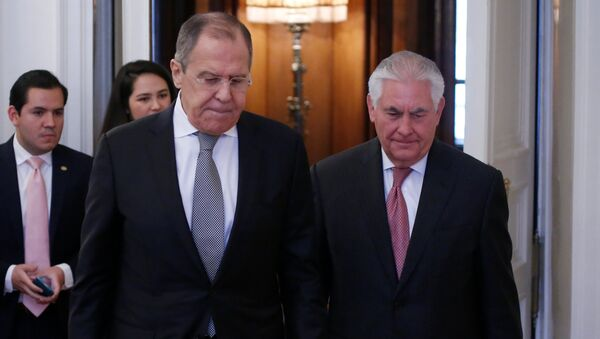 Russian Foreign Minister Sergei Lavrov and U.S. Secretary of State Rex Tillerson enter a hall during their meeting in Moscow, Russia, April 12, 2017 - Sputnik International