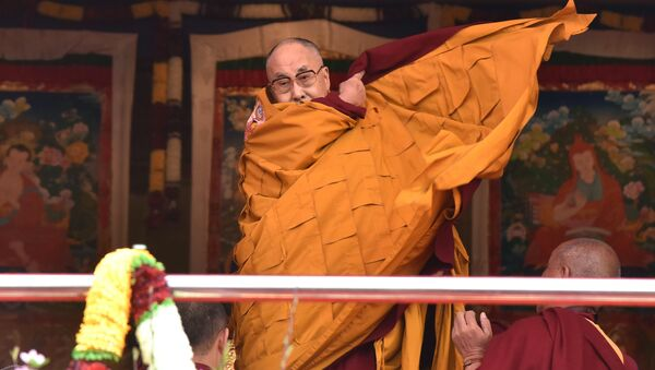 Exiled Tibetan spiritual leader the Dalai Lama adjusts his shawl as he came to deliver his religious teaching at Yiga Choezin ground at in Tawang District near India-china border in India's north-eastern state of Arunachal Pradesh state, on April 8, 2017 - Sputnik International