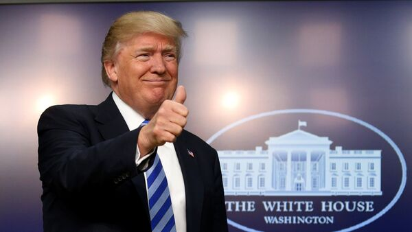 U.S. President Donald Trump gives a thumbs up as he hosts a CEO town hall on the American business climate at the Eisenhower Executive Office Building in Washington, U.S., April 4, 2017 - Sputnik International