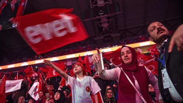 Supporters wave Turkey's national flags and a flag reading Yes in Turkish (L) during a campaign rally of Turkey's president on April 12, 2017 during a 15 July Martyrs meeting and a campaign rally for the yes vote in a constitutional referendum in Istanbul - Sputnik International