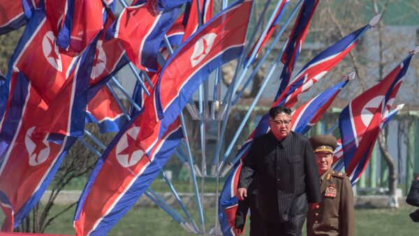 DPRK leader Kim Jong-il, center, at a ceremony to open a new residential area on Ryomyong Street in Pyongyang. - Sputnik International