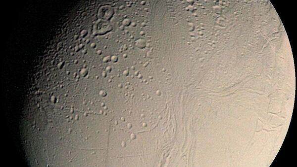 Small inner moon of Saturn, Enceladus seen here in a mosaic of Voyager 2. (File) - Sputnik International