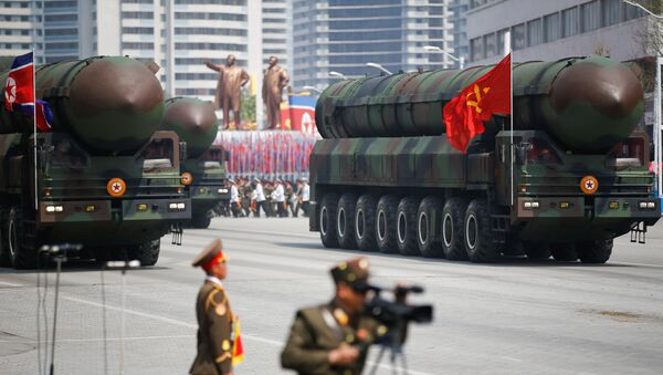 Missiles are driven past the stand with North Korean leader Kim Jong Un and other high ranking officials during a military parade marking the 105th birth anniversary of country's founding father Kim Il Sung, in Pyongyang April 15, 2017 - Sputnik International