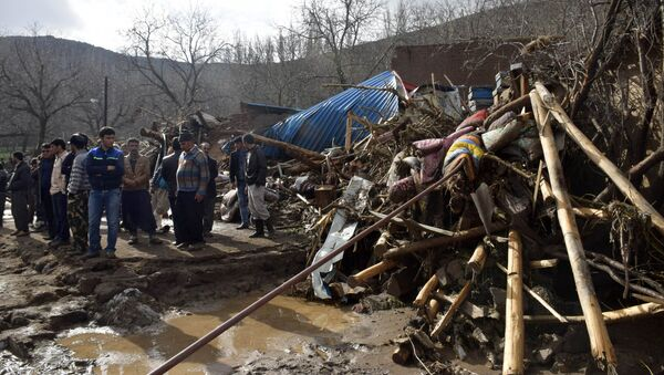 In this picture released by Islamic Republic News Agency, IRNA, villagers stand next to wreckages of buildings in Chenar village near city of Ajabshir in northwestern Iran, Saturday, April 15, 2017. - Sputnik International