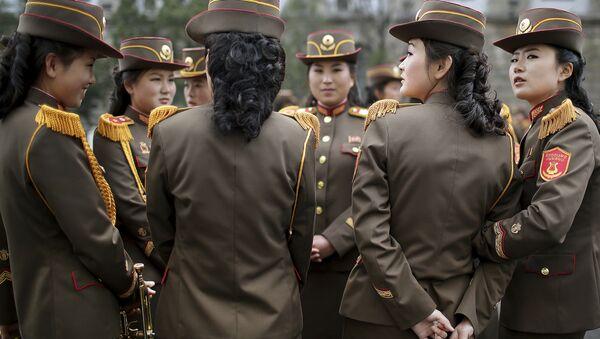 North Korean military band members chat before a military parade on Saturday, April 15, 2017 - Sputnik International