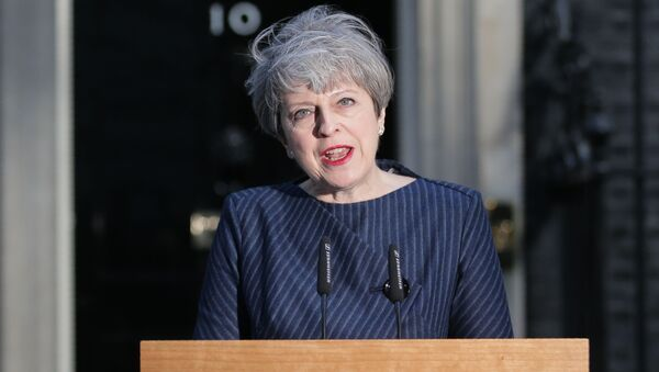 British Prime Minister Theresa May speaks to the media outside 10 Downing Street in central London on April 18, 2017. - Sputnik International
