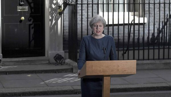 Britain's Prime Minister Theresa May speaks to the media outside 10 Downing Street, in central London, Britain April 18, 2017 - Sputnik International