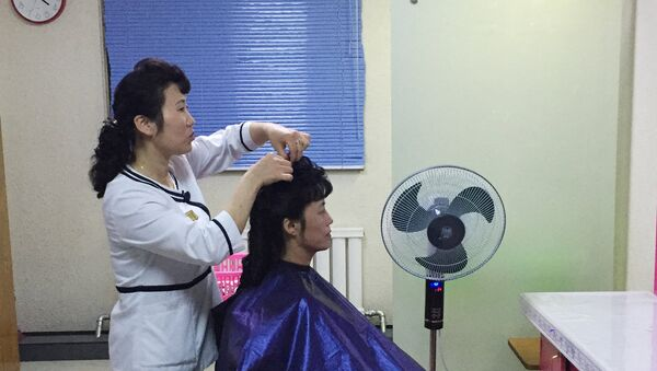 A woman in a hair salon which opened at one of the advanced industrial facilities in Pyongyang - Sputnik International