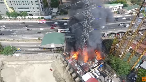 Tower Engulfed in Flames Collapses - Sputnik International