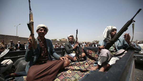 Tribesmen loyal to Houthi rebels ride on a patrol truck during a gathering aimed at mobilizing more fighters into battlefronts in several Yemeni cities, in Sanaa, Yemen, Thursday, Aug. 11, 2016. - Sputnik International