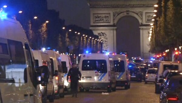 In this image made from video, police attend the scene after an incident on the Champs-Elysees in Paris, Thursday April 20, 2017. - Sputnik International