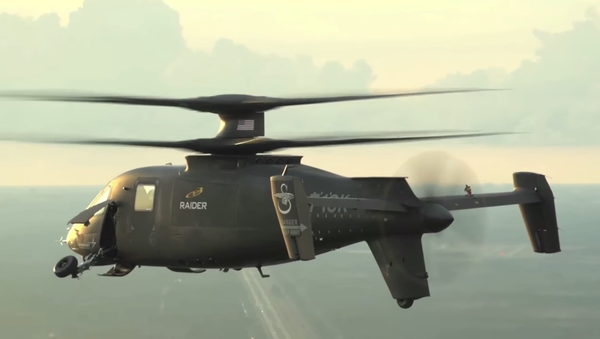 The S-97 Raider, Sikorsky's newest light tactical helicopter, withdrawing its landing wheels during a video demonstration. - Sputnik International