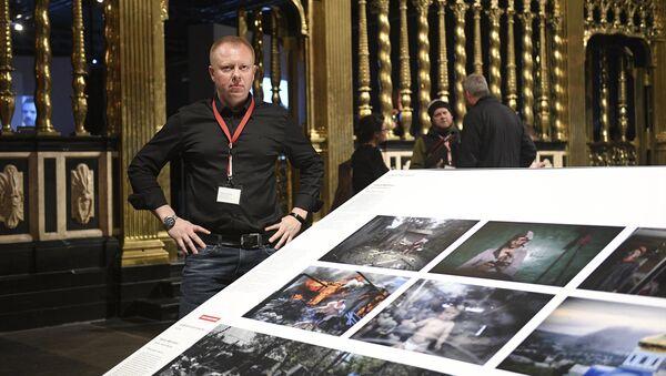 Valery Melnikov, Sputnik photojournalist and winner of multiple leading international photography contests at 2017 World Press Photo exhibition. - Sputnik International