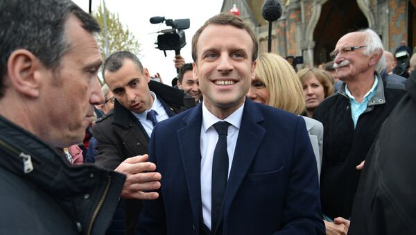 Emmanuel Macron, leader of En Marche! movement, center, is seen here in Le Touquet-Paris-Plage in the Pas-de-Calais department during the first round of the French presidential elections. - Sputnik International