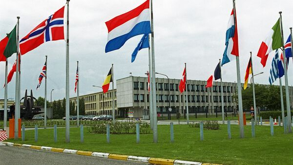 NATO member states' flags outside the European headquarters of the North Atlantic Treaty Organization in Brussels. (File) - Sputnik International