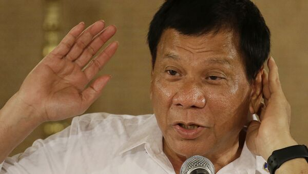 Philippine President Rodrigo Duterte gestures as he answers questions from reporters during a press conference - Sputnik International
