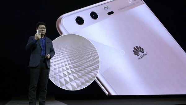 Chief executive officer of consumer devices division for Huawei Technologies Co. Richard Yu presents the new phone Huawei P10 Plus before the Mobile World Congress in Barcelona, Spain - Sputnik International