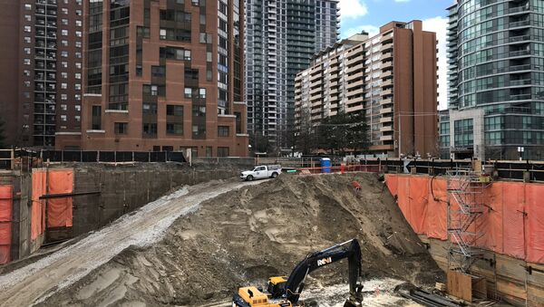 Construction equipment is parked at the bottom of a pit on the site of a new condominium complex off Redpath Avenue in Toronto, Ontario, Canada April 1, 2017 - Sputnik International