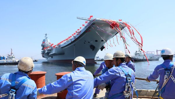China's first domestically built aircraft carrier is seen during its launching ceremony in Dalian, China April 26, 2017 - Sputnik International