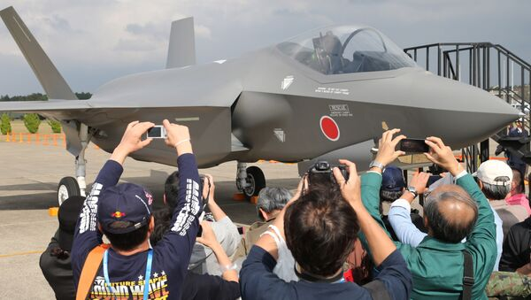 Visitors photograph a mock-up of the F-35 fighter jet displayed at the annual Self-Defense Forces Commencement of Air Review at Hyakuri Air Base, north of Tokyo, Sunday, Oct. 26, 2014 - Sputnik International