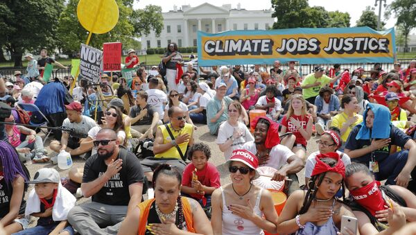 Demonstrators sit on the ground along Pennsylvania Ave. in front of the White House in Washington, Saturday, April 29, 2017, during a demonstration and march. - Sputnik International