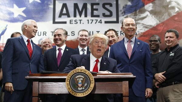 President Donald Trump, joined by Vice President Mike Pence, Secretary of Veterans Affairs David Shulkin, Secretary of Commerce Wilbur Ross, and others looks up as he signs an Executive Order on the Establishment of Office of Trade and Manufacturing Policy at The AMES Companies, Inc., in Harrisburg, Pa., Saturday, April, 29, 2017 - Sputnik International